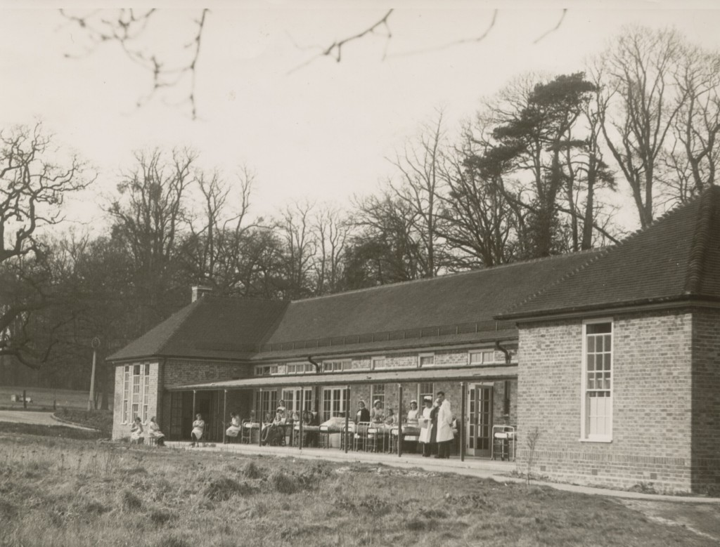Botley's Park War Emergency Hospital, later St. Peter's Hospital, Chertsey, showing patients in beds on the veranda, 1940 - 1945