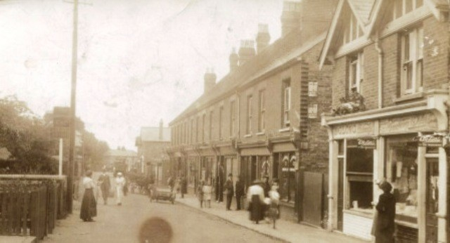 Victoria Street, Englefield Green showing the Armstrong Gun public house and G.Long, fishmongers; c.1919