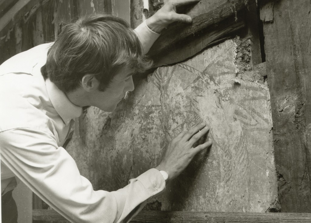 Examination of the Tudor Wall panels in situ at Manor Farm, Egham, prior to their removal. 1971